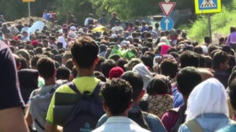migranti-marcia